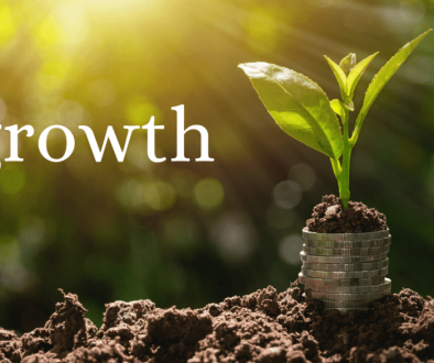 My word of 2019 - growth - Picture of a plant growing out of a stack of coins
