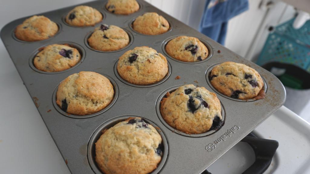 Vegan frozen blueberry muffins in a muffin tin