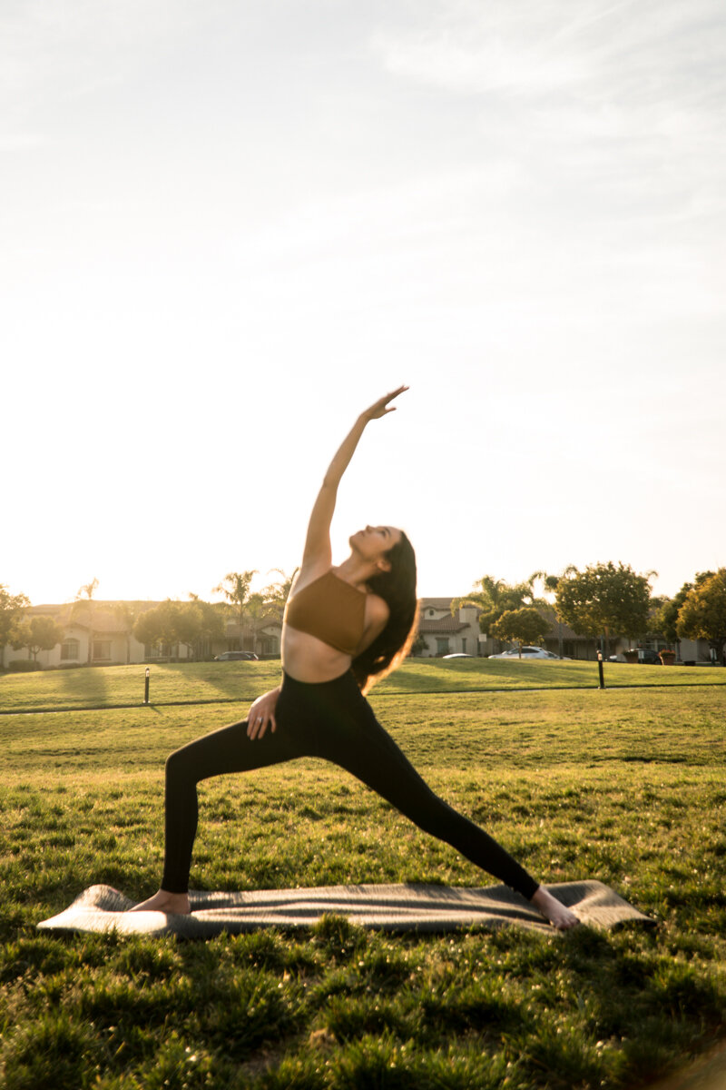 Jess Marie Larrain doing yoga outside