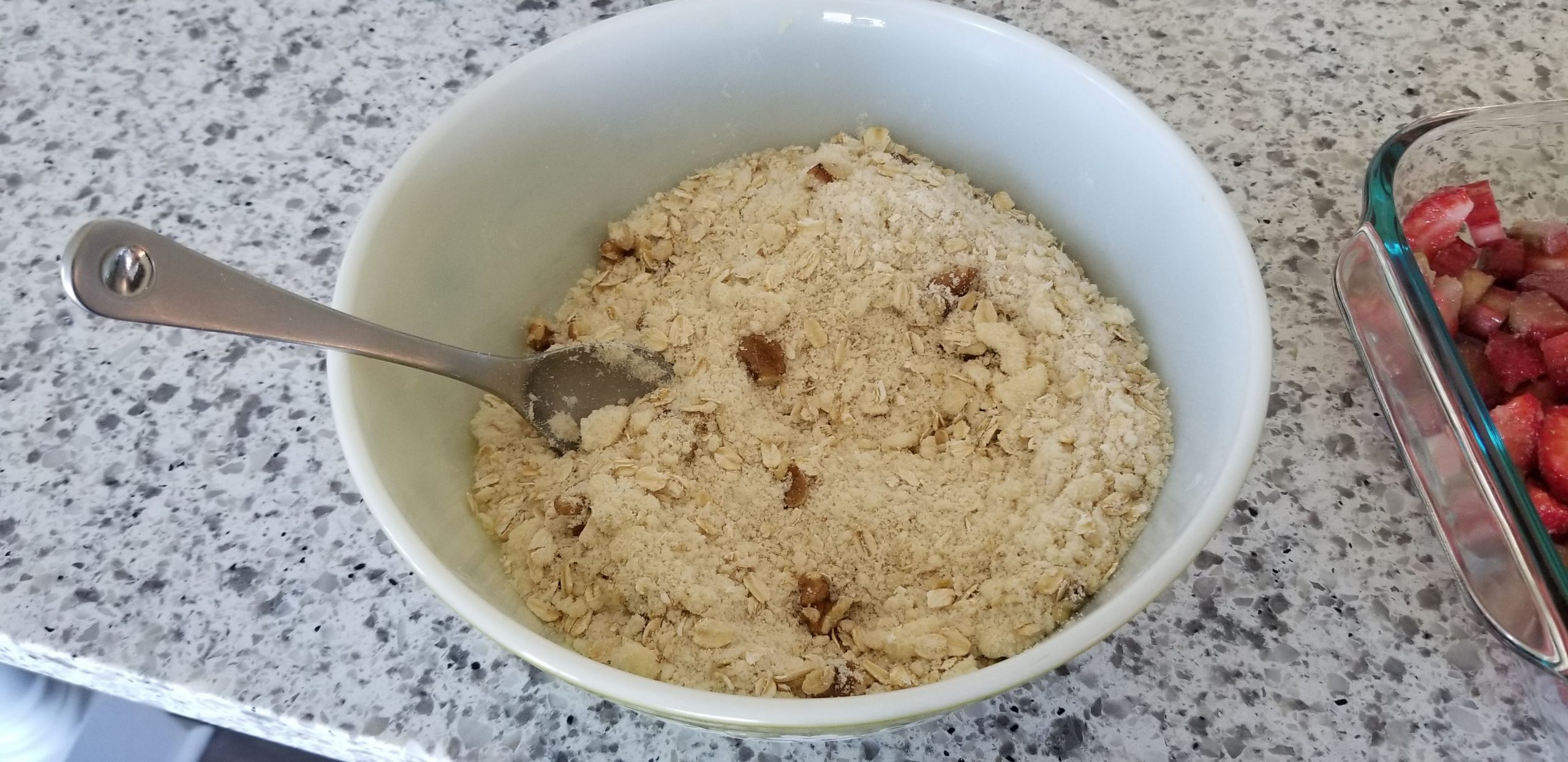 The crisp topping for dairy-free strawberry rhubarb crisp in a bowl
